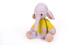 Little Knitted Baby Elephant On White Background. Baby Elephant Toy Sitting On White Background. Copy Space