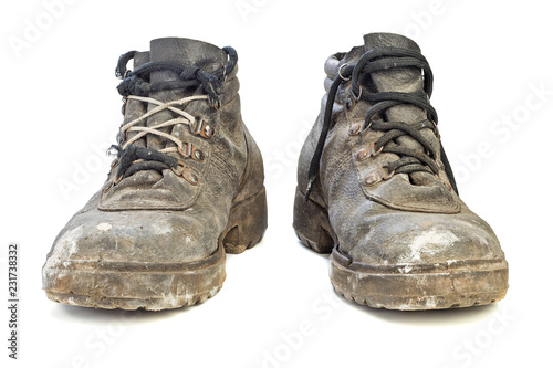 worn-out old work boots isolated on white background