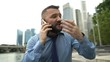 Angry businessman talking on cellphone in the city