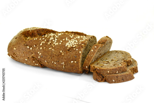 Spoed Foto op Canvas Brood slices of black bread with pumpkin seed and sesame isolated on white background