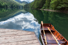 Small Wooden Rowboats For Water Trip On Shore Of Biogradskoe Lake. The Biogradska Gora National Park. Montenegro, Europa