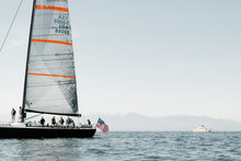 Sailboat With American Flag On End In The Ocean For Yacht Race