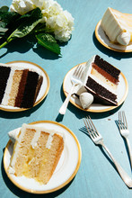 Various Cakes On Plates