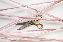 Silk Ribbon Crisscrossing Over A Pair Of Scissors