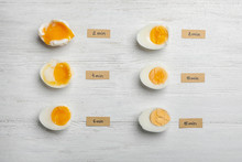 Various Types Of Boiled Eggs On White Wooden Background, Flat Lay. Cooking Time