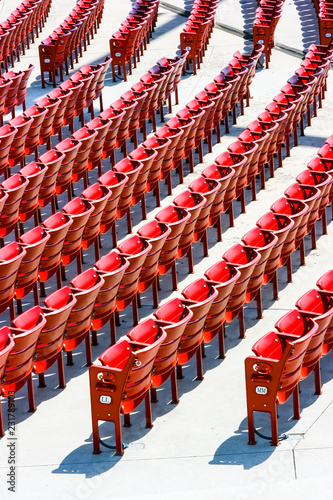 Foto op Canvas Theater Vertical view of red plastic seats in rows