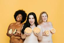 Diverse Curvy Nude Women Holdi...