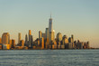 New York City skyscrapers at sunset and Hudson River from Hoboken promenade.