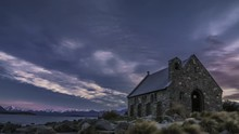 Church Of The Good Shepherd On The Bank Of Lake Tekapo. One Of The Main Tourist Attractions On The South Island During Precious Few Quiet Moments With No People Around. Timelapse Video.