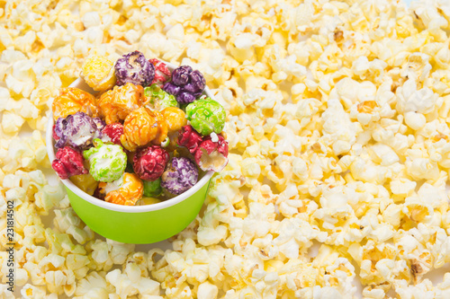 Foto op Canvas Buffet, Bar on the background of white salted popcorn, a bowl with a colorful, sweet delicacy