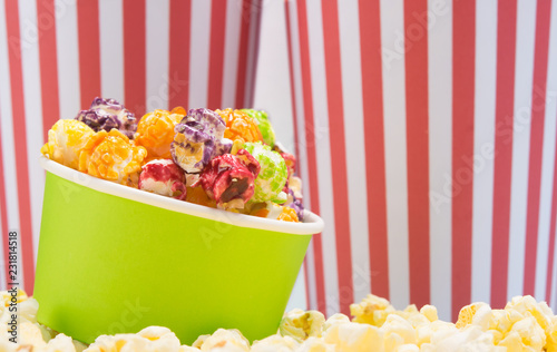 Foto op Canvas Buffet, Bar on the background of striped glasses, a bowl of fruit popcorn