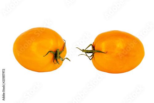 Fotografía  Orange tomatoes isolated on white