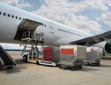 Process Of Handling. Luggage Loading With High Loader At  Airport.
