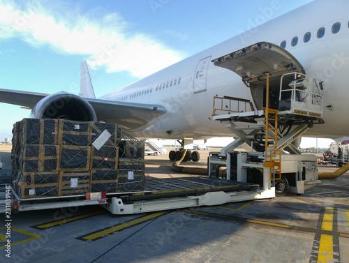 Fotografía Process of cargo handling. Parcels loading with high loader