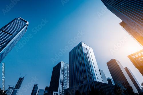 Obraz Modern office building against blue sky. - fototapety do salonu