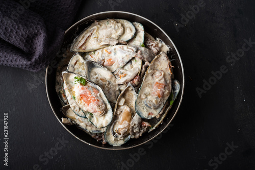 Mussels with Blue Cheese Sauce and Garlic Baguette.