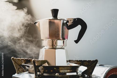 Fotografía Coffee beans in Moka pot and smoke.