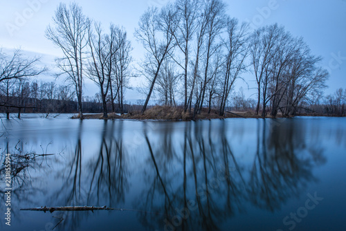 Tuinposter Meer / Vijver picturesque view of first snow on Ontario lake with dramatic sky, Canada