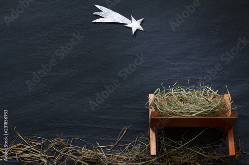 Fotografija Manger and star of Bethlehem abstracy christmas background nativity scene on bla