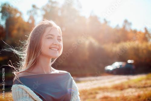 Canvas Print Pretty girl posing on camera and enjoying sunny autumn day.