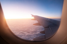 Morning Light From Window Of  Airplane Wing