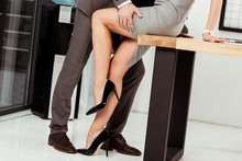 Partial View Of Business Colleagues Flirting At Workplace In Office, Offirce Romance Concept