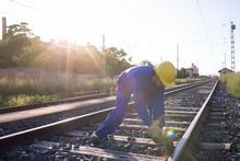Worker Working On Railroad