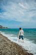 Father and daughter walk along the shore. English promenade, Nice, French Riviera, France