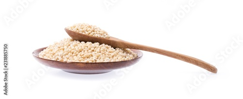 Vászonkép Barley rice in wood spoon on plate isolated on white background