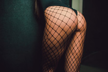 Female Legs In Black Fishnet S...