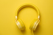 canvas print picture - Yellow headphones on yellow background. Music concept.