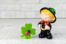 Small Chimney Sweep With Four-leaf Clover As Good Luck Charm