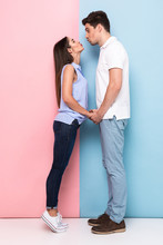 Full Length Image Of Caucasian Man And Woman 20s Kissing Together, Isolated Over Colorful Background
