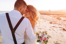 Bride And Groom On The Seashor...