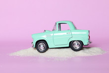 Miniature Car On Pink Background, Insurance Concept