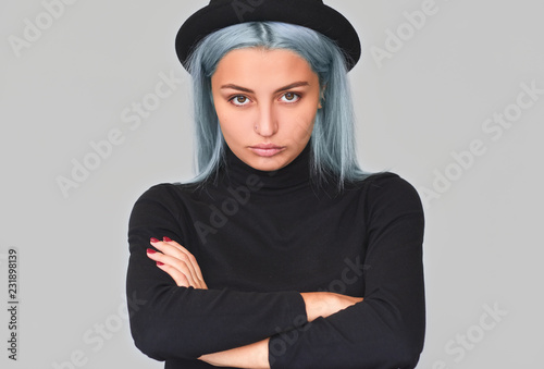 Studio Portrait Of Beautiful Young Teenager Woman With Blue Hair