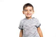 Boy Having Fun On Studio White Background