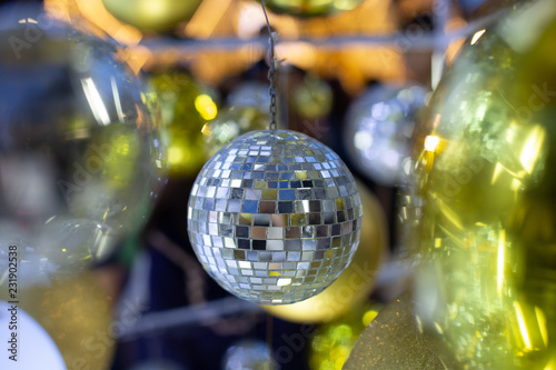 Christmas Disco Ball.Silver Christmas Disco Ball On A Blurred Festive Background