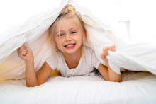 A Cheerful Little Girl In Bed ...