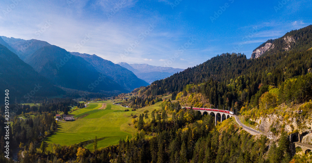 Fototapety, obrazy: Panoramic View of a red train crossing the Landwasser Viaduct in the Swiss Alps
