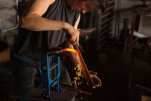 Female Metalsmith Shaping Hors...