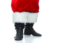 Cropped View Of Santa Claus Posing In Boots Isolated On White