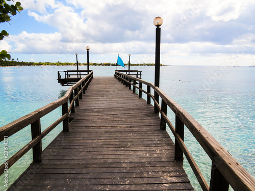 La Romana, Dominican Republic - a wooden pier in the turquoise water of the tropical island of Dominican Republic.
