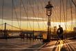 Bicyclist on Brooklyn Bridge during sunrise in New York. USA