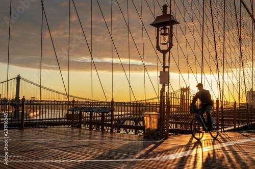 Staande foto New York City Bicyclist on Brooklyn Bridge during sunrise in New York. USA