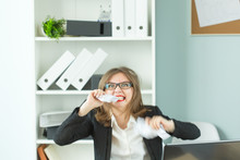 Stress, Office And People Concept - A Woman, Worker With A Lot Of Work Sitting At Table In Office, Tearing A Paper By Teeth