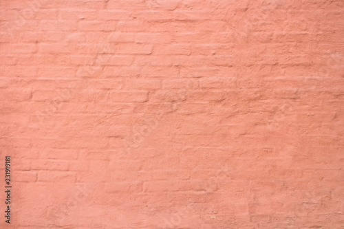 Stucco over brick wall  Plaster warm terracotta color on a brick