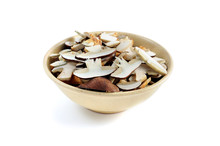 Bay Bolete Mushrooms In A Bowl. Isolated White Background.