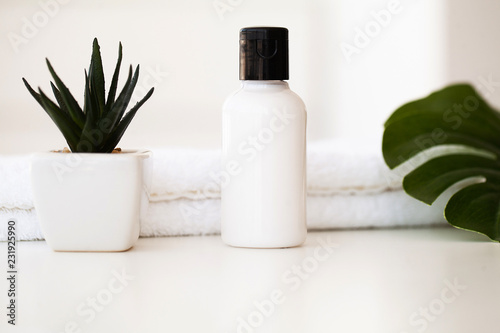 Poster Spa Wellness Products and Cosmetics. Spa still life with blossoms of rose and essential oils