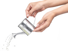 Hand Holding A Small Metal Watering Can With Spout Isolated On White Background